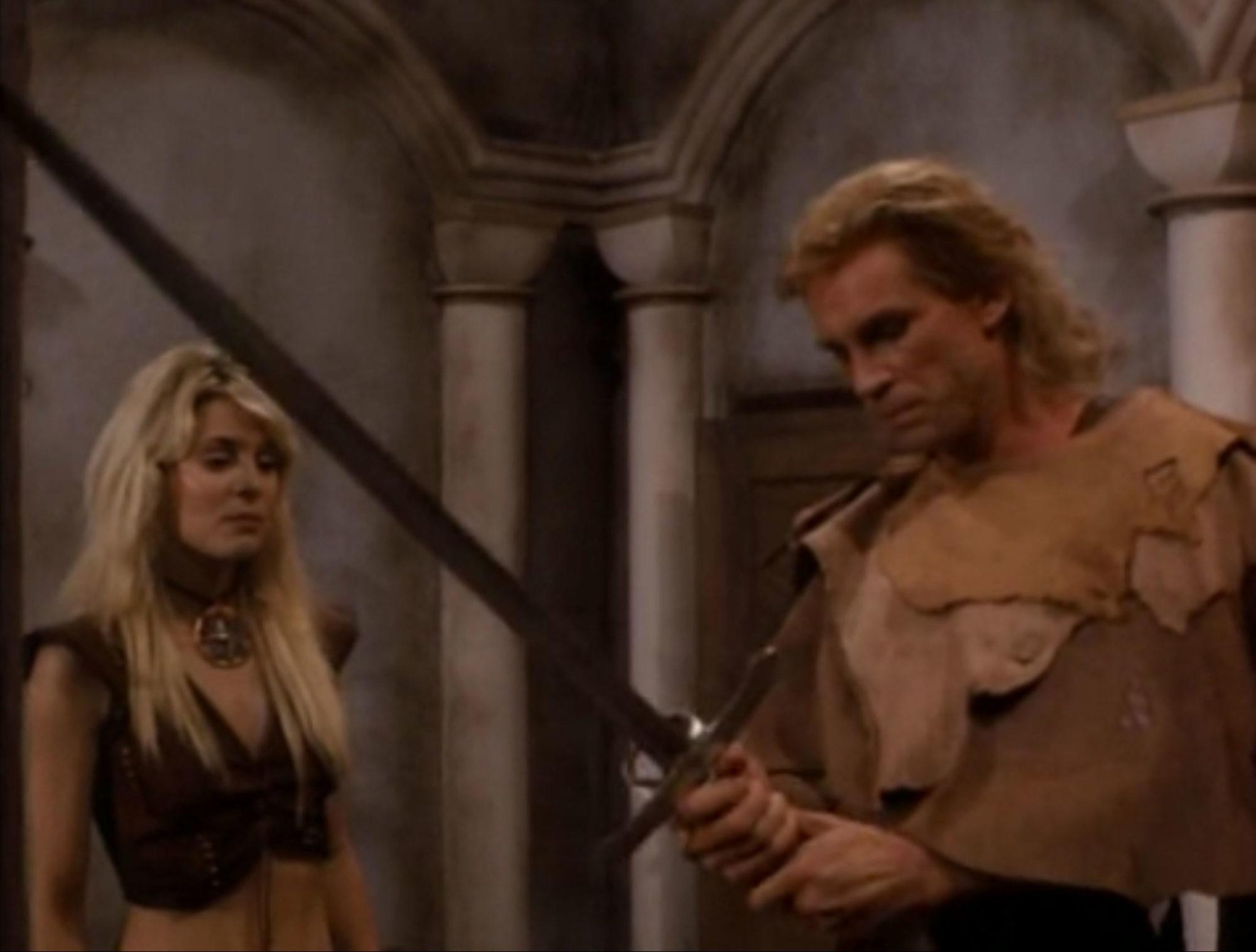 Rick Hill and Maria Ford in Deathstalker IV: Match of Titans
