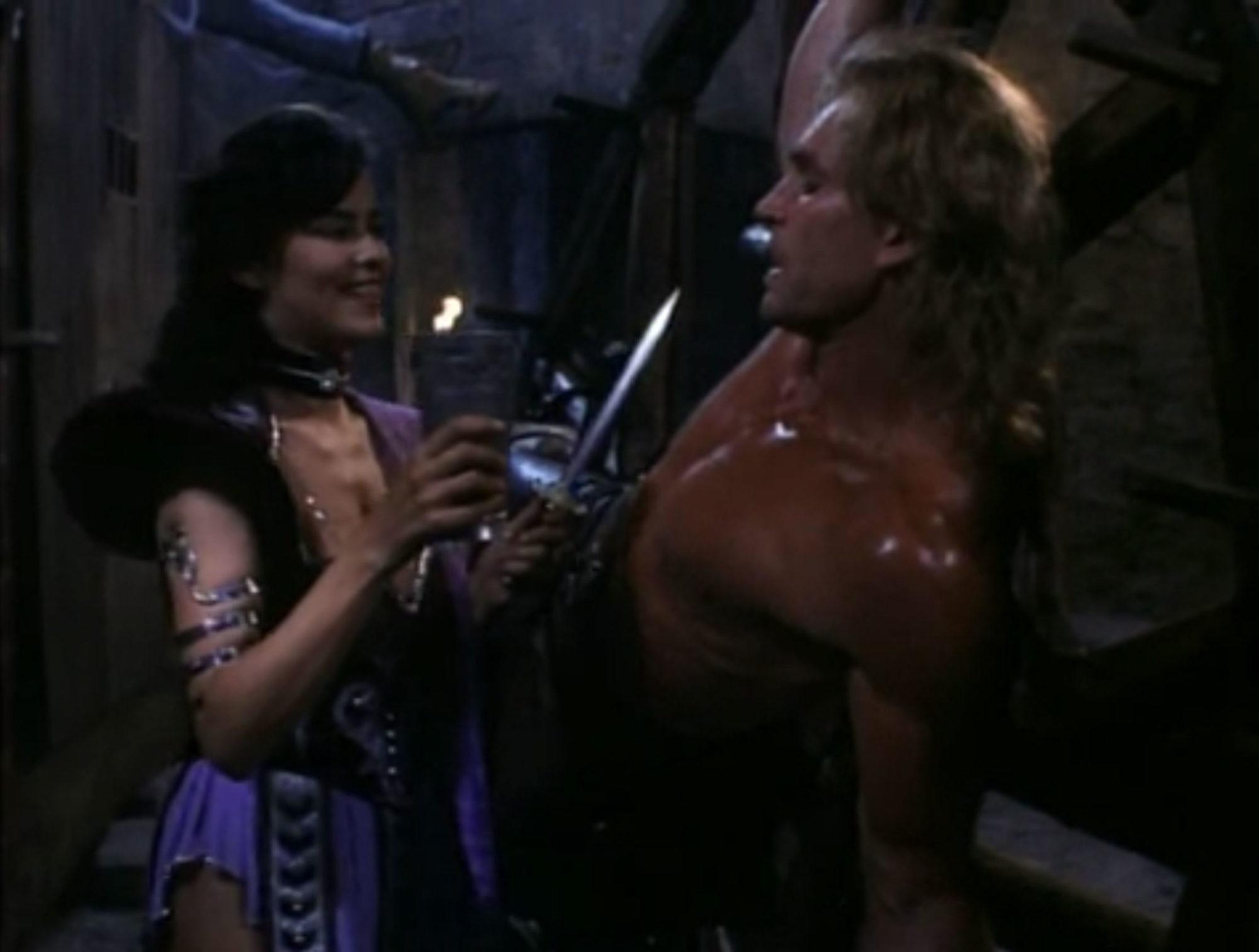 Michelle Moffett and Rick Hill in Deathstalker IV: Match of Titans