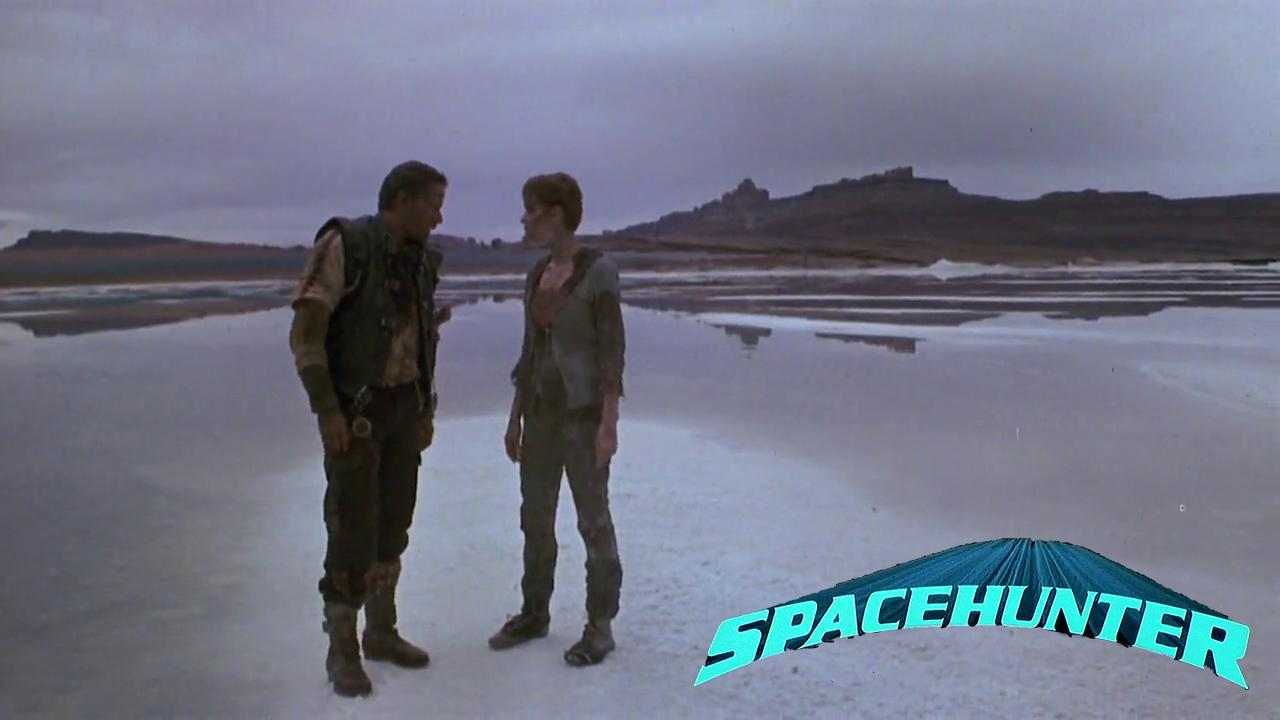 Molly Ringwald and Peter Strauss in Spacehunter: Adventures in the Forbidden Zone (1983)