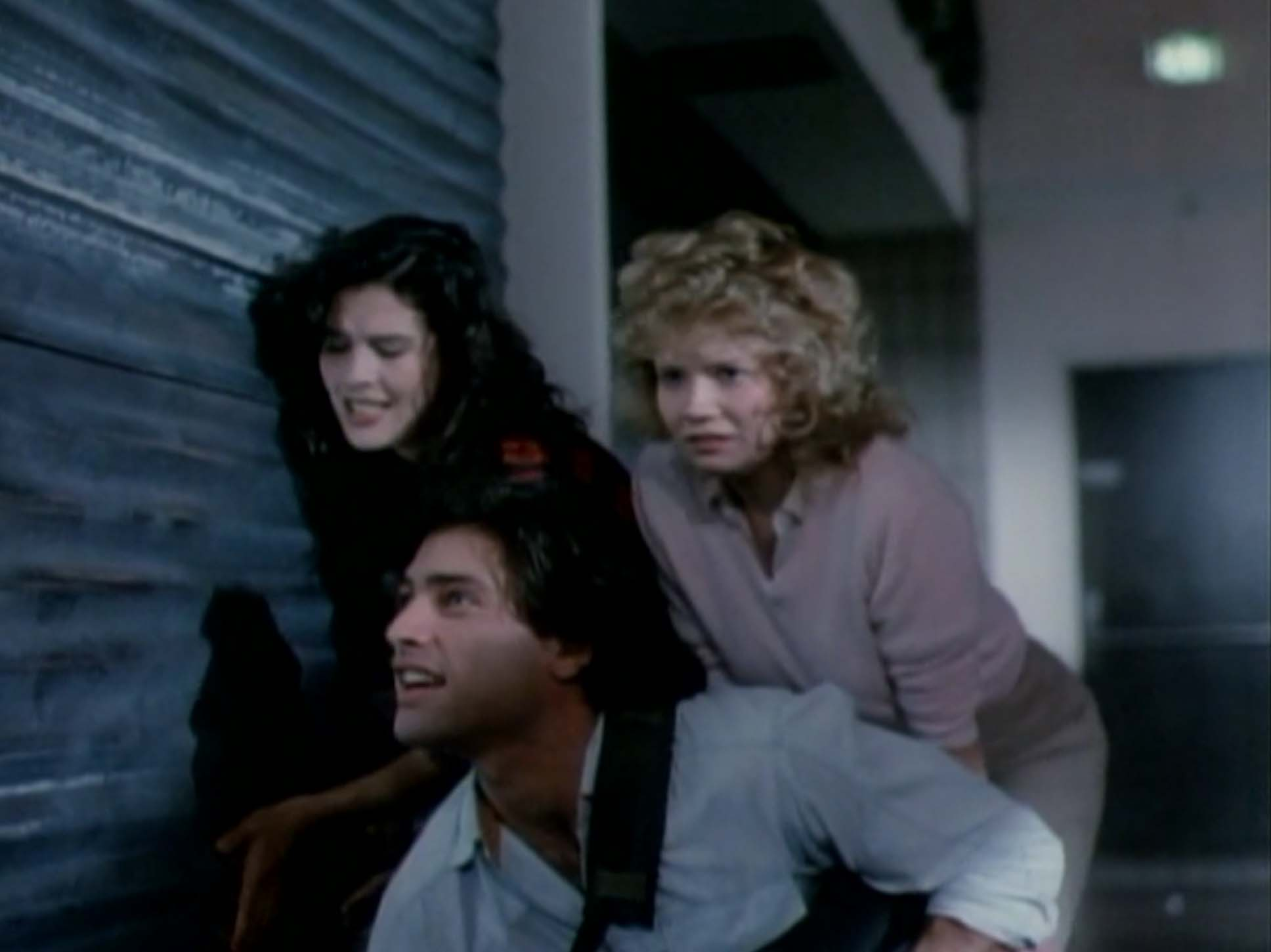 Kelli Maroney, Karrie Emerson and Russell Todd in Chopping Mall (1986)