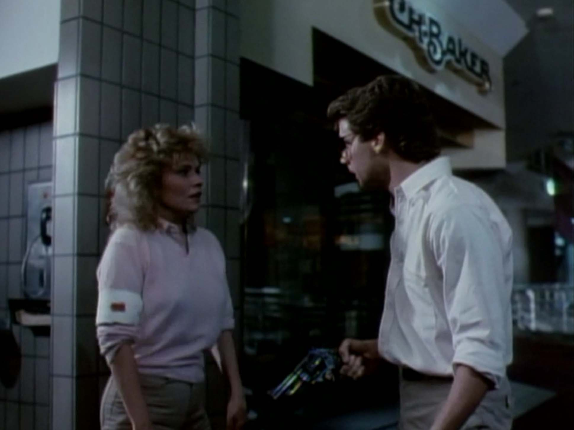 Kelli Maroney and Tony O'Dell in Chopping Mall (1986)