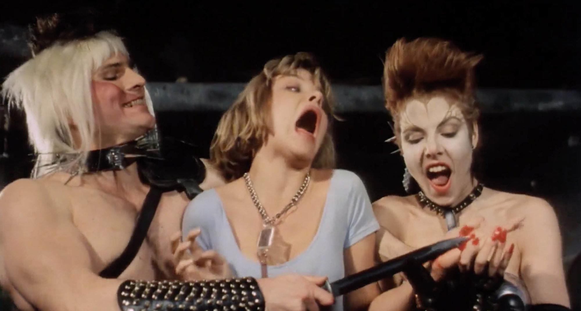 Janelle Brady, Robert Pritchard and Lauren Heather McMahon in Class Of Nuke 'Em High (1986)