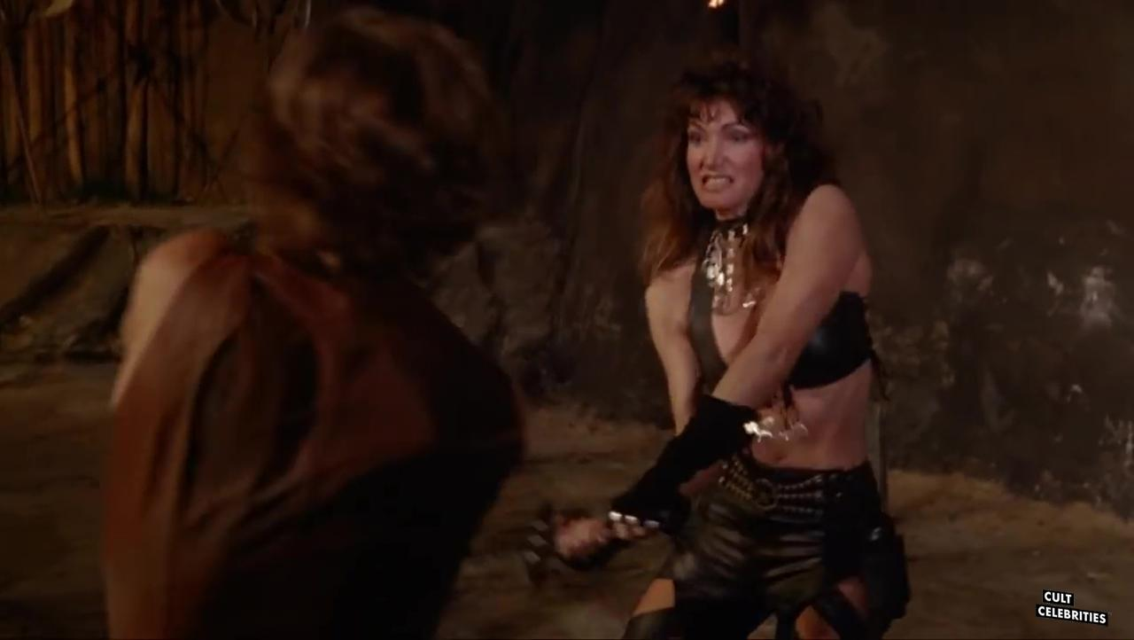 Toni Naples and John Terlesky in Deathstalker II: Duel of the Titans (1987)