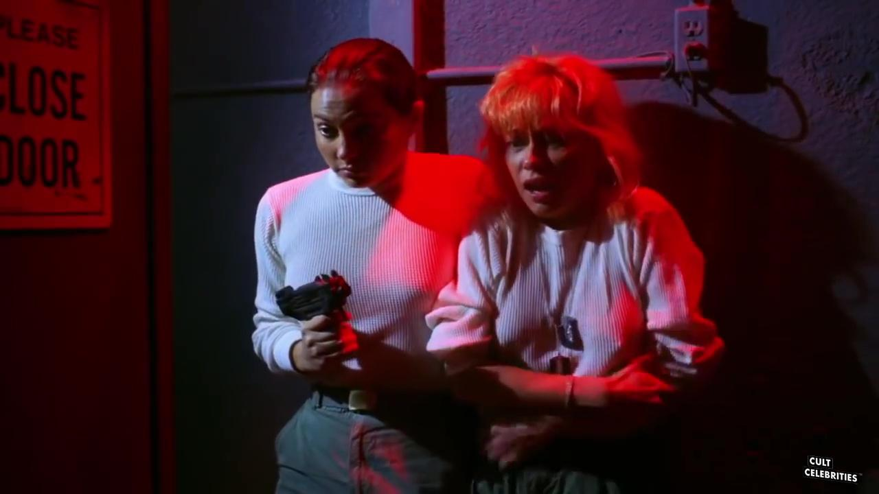 Linnea Quigley and Ashlyn Gere in Creepozoids (1987)