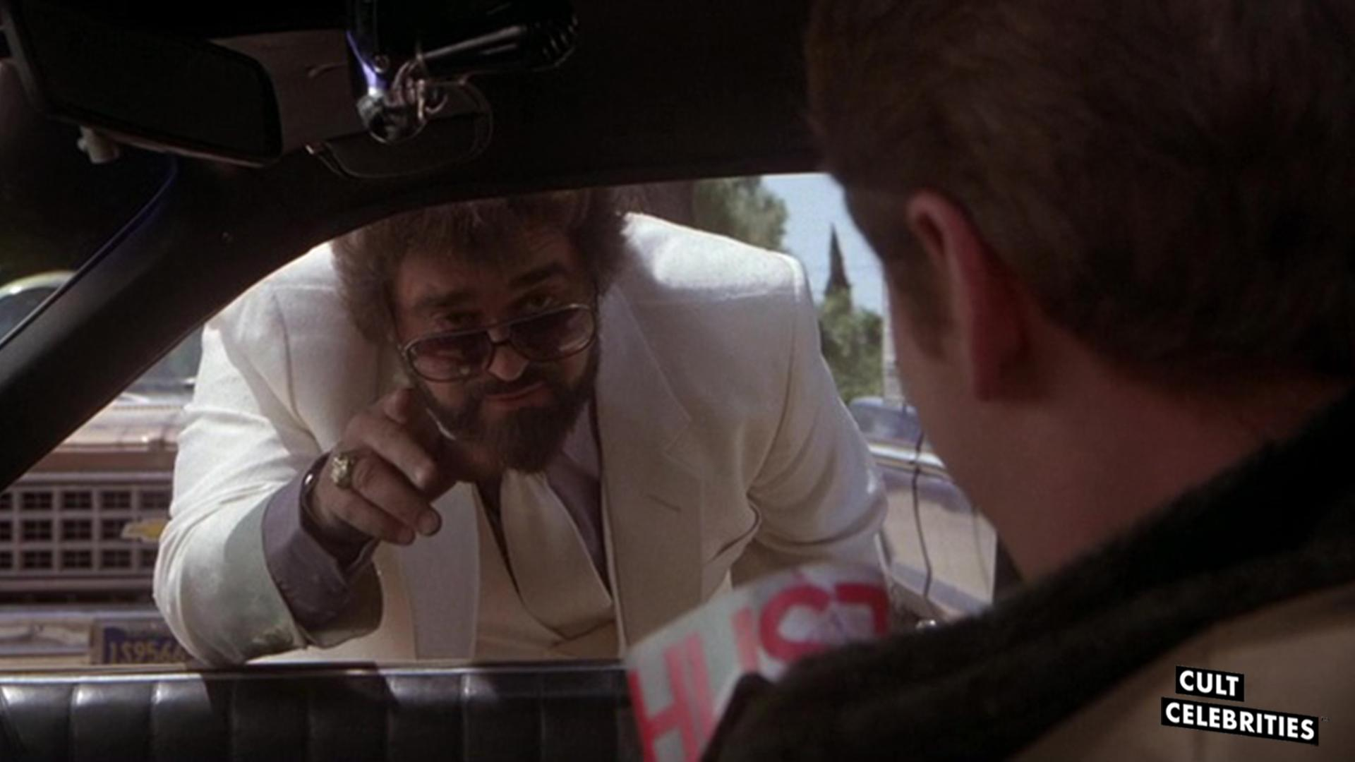 Wolfman Jack as Reverend Billy in the 1980 comedy horror film Motel Hell.