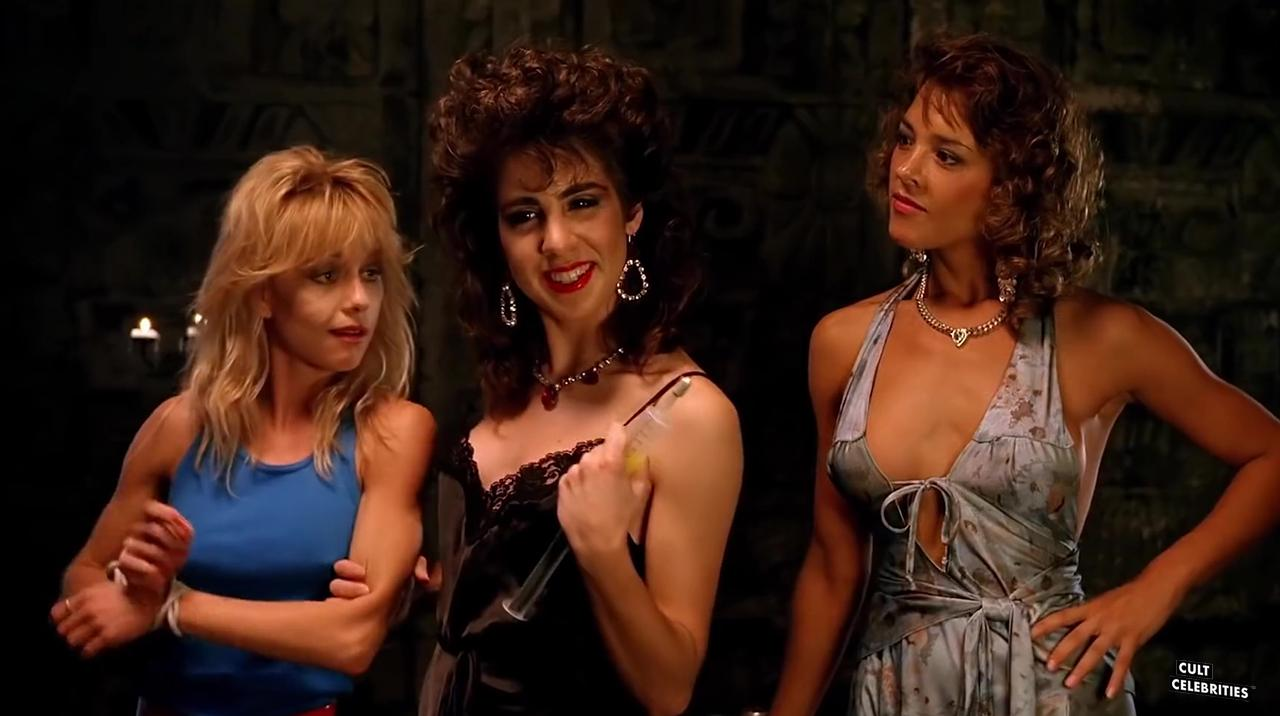 Linnea Quigley, Esther Elise and Michelle Bauer in Hollywood Chainsaw Hookers (1988)