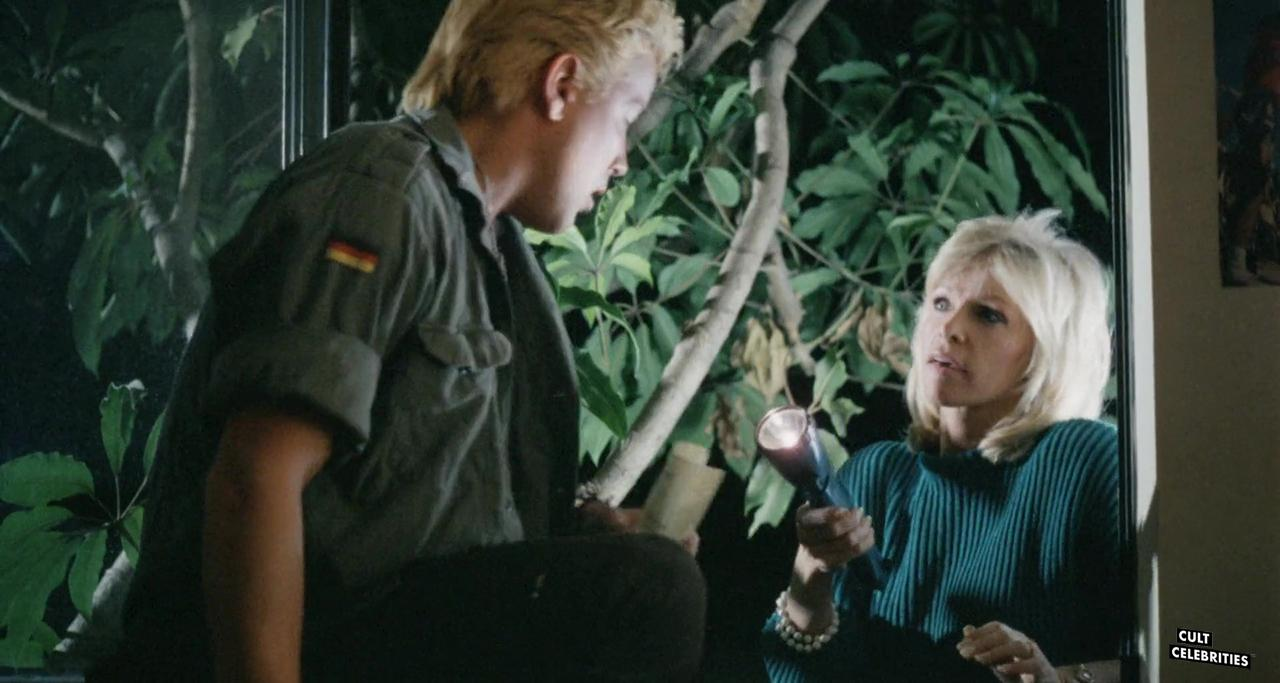 Bobbie Bresee and Tom Shell in Surf Nazis Must Die (1987)