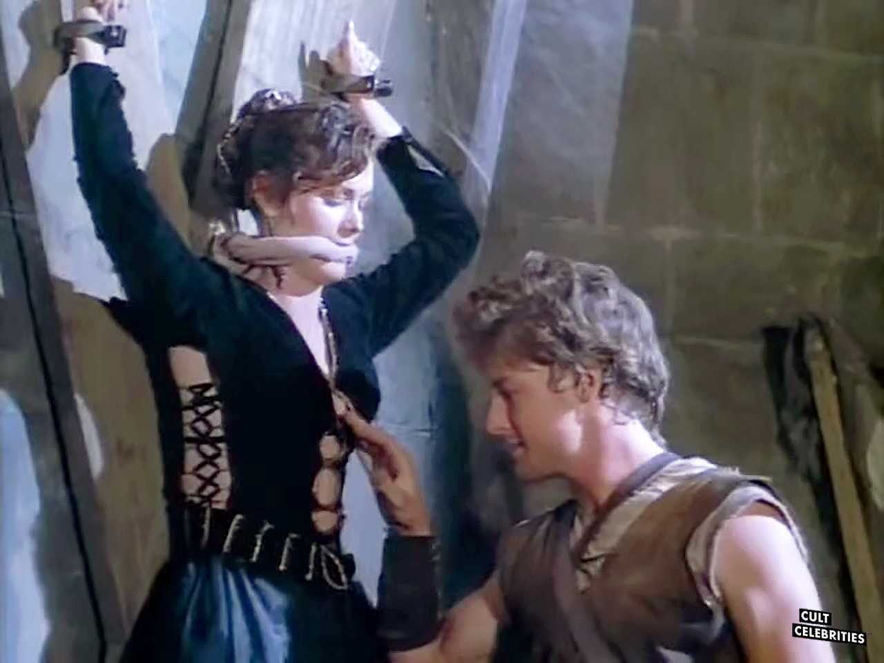 Terri Treas and John Allen Nelson in Deathstalker and the Warriors from Hell (1988)