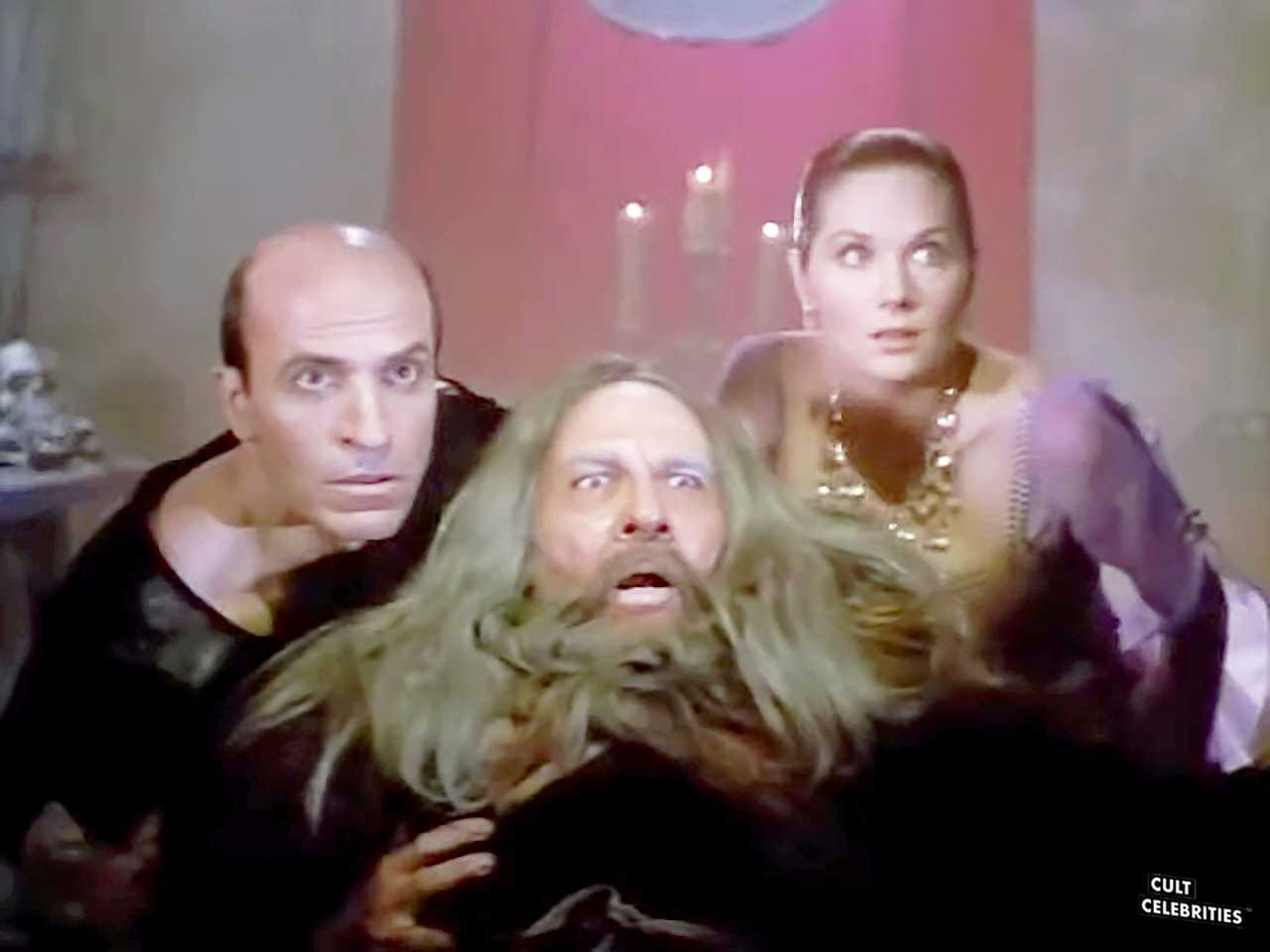 Terri Treas, Agustín Salvat and Thom Christopher in Deathstalker and the Warriors from Hell (1988)