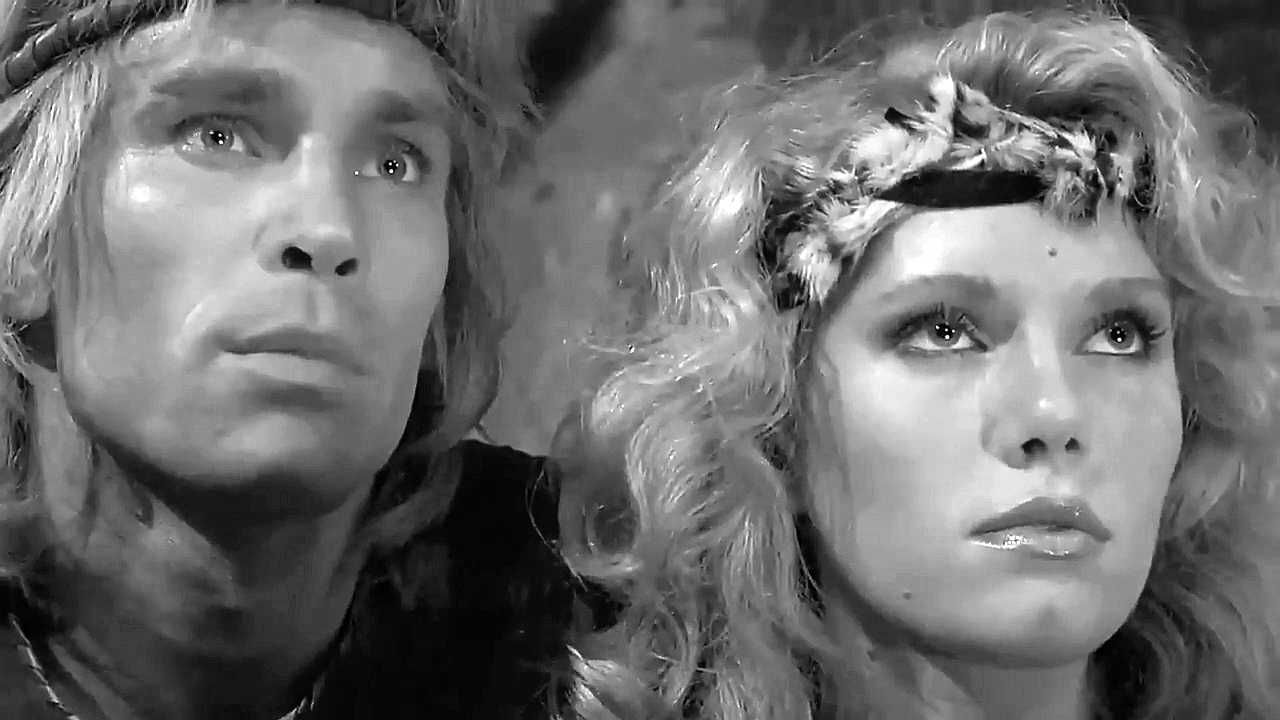 Lana Clarkson and Richard Hill in Deathstalker (1983)